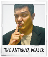Na'a Murad as The Antiques Dealer